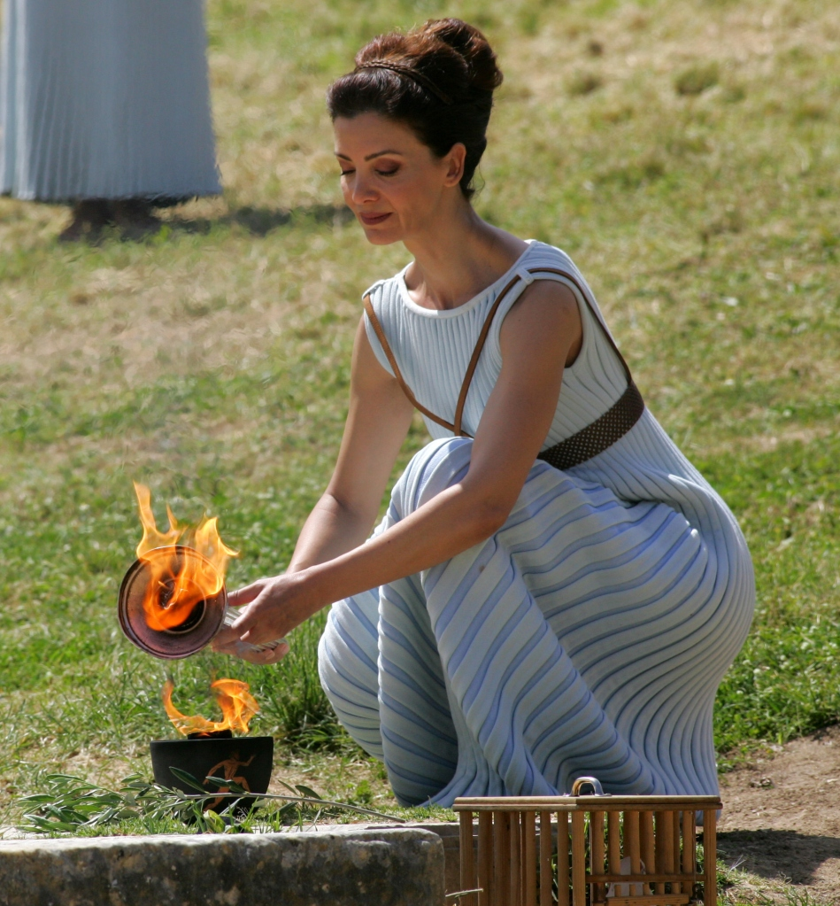 OLYMPIA, GREECE - APRIL 20: Actress Katerina Lechou acting the high pristess holds the Archaic Pot at the Ancient Stadium during the Rehearsal for the Lighting Ceremony of the Olympic Flame at Ancient Olympia on April 20, 2016 in Olympia, Greece. (Photo by Milos Bicanski/Getty Images)