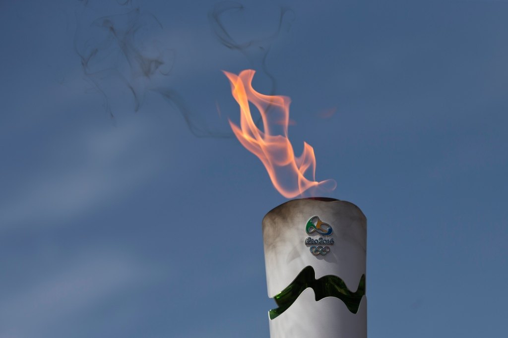 A lit torch of the Rio de Janeiro Olympic games during a dress rehearsal for the lighting of the Rio Olympics flame, in Ancient Olympia, southern Greece, on Wednesday, April 20, 2016. The meticulously choreographed ceremony will be repeated Thursday in the ruined birthplace of the ancient Olympics in southern Greece, in the presence of top International Olympic Committee and Rio organizing officials. That will touch off a relay that will conclude with the Rio Games opening ceremony in August. (AP Photo/Petros Giannakouris)