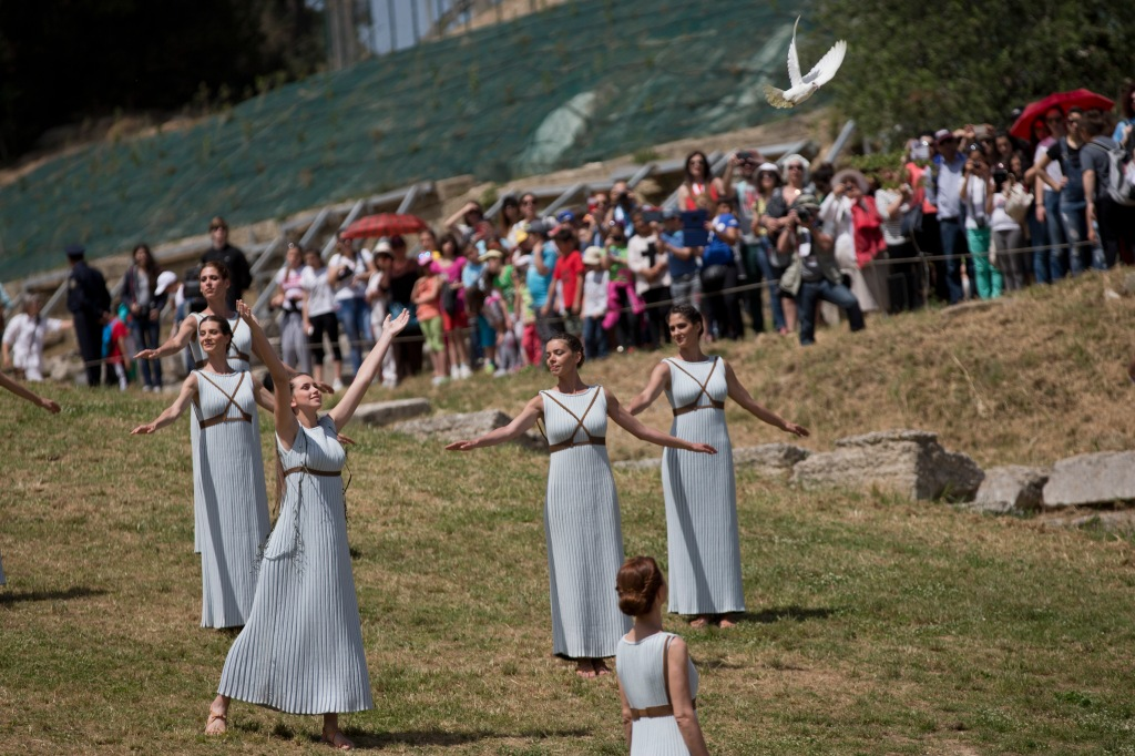 A priestess releases a white dove during the dress rehearsal for the lighting of the Rio Rio de Janeiro Olympics flame, in Ancient Olympia, southern Greece, on Wednesday, April 20, 2016. The meticulously choreographed ceremony will be repeated on Thursday in the ruined birthplace of the ancient Olympics in southern Greece, in the presence of top International Olympic Committee and Rio organizing officials. That will touch off a relay that will conclude with the Rio Games opening ceremony in August. (AP Photo/Petros Giannakouris)