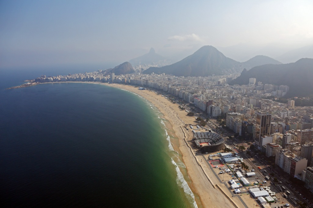 RIO DE JANEIRO, BRAZIL - JULY 25: Work continues on the Olympic Beach Volleyball Arena on Copacabana beach in preparation for the 2016 Summer Olympic Games on July 25, 2016 in Rio de Janeiro, Brazil. (Photo by Michael Heiman/Getty Images)