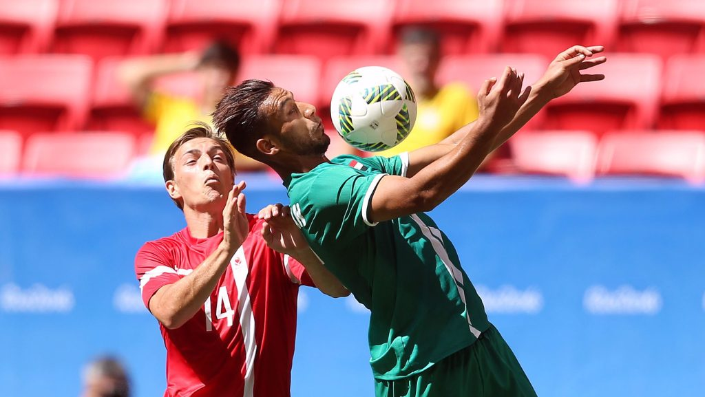 BRASILIA, BRAZIL - AUGUST 04: Nielsen Casper #14 of Denmark and Hammadi Ahmed #7 of Iraq vie for the ball at Mane Garrincha Stadium on August 4, 2016 in Brasilia, Brazil. (Photo by Celso Junior/Getty Images)