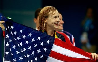 RIO DE JANEIRO, BRAZIL - AUGUST 07: Gold medalist Katie Ledecky of the United States poses during the medal ceremony for the Women's 400m Freestyle Final on Day 2 of the Rio 2016 Olympic Games at the Olympic Aquatics Stadium on August 7, 2016 in Rio de Janeiro, Brazil. (Photo by Adam Pretty/Getty Images)