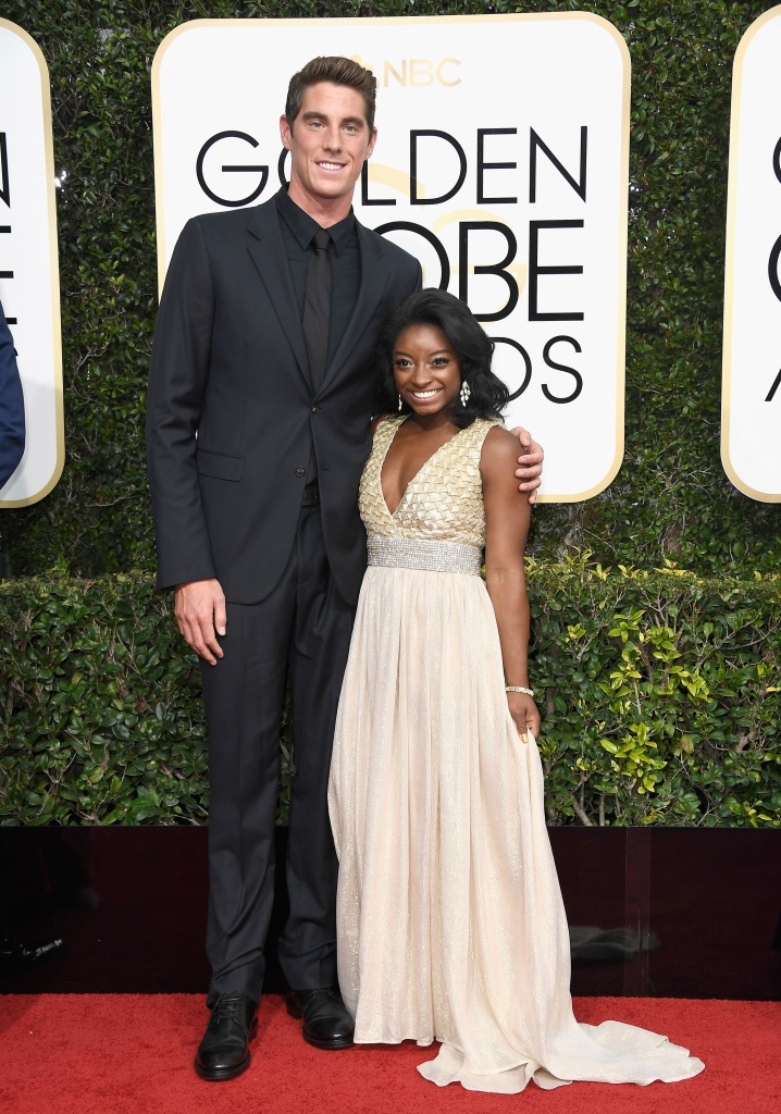 BEVERLY HILLS, CA - JANUARY 08: (L-R) Swimmer Conor Dwyer and gymnast Simone Biles attend the 74th Annual Golden Globe Awards at The Beverly Hilton Hotel on January 8, 2017 in Beverly Hills, California. (Photo by Frazer Harrison/Getty Images)