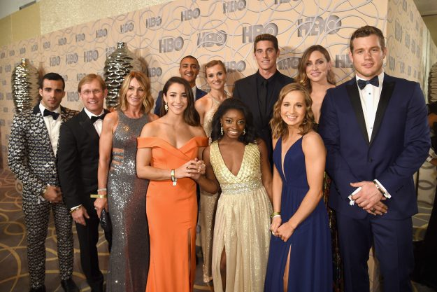 BEVERLY HILLS, CA - JANUARY 08: (L-R) Gymnast Danell J. Leyva, Bart Conner, Nadia Comaneci, gymnast Aly Raisman, Ashton Eaton, Brianne Theisen-Eaton, Simone Biles, swimmer Conor Dwyer, gymnast Madison Kocian, a guest and football player Colton Underwood attend HBO's Official Golden Globe Awards After Party at Circa 55 Restaurant on January 8, 2017 in Beverly Hills, California. (Photo by Joshua Blanchard/Getty Images)