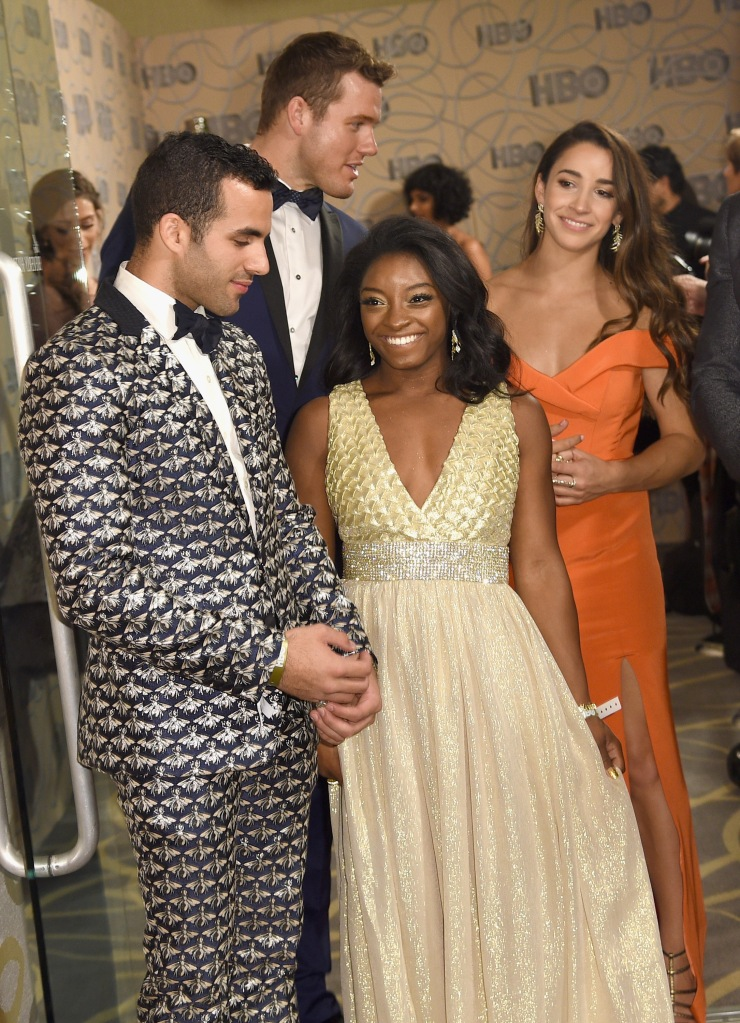 BEVERLY HILLS, CA - JANUARY 08: (L-R) Gymnast Danell J. Leyva, football player Colton Underwood, gymnast Simone Biles and gymnast Aly Raisman attend HBO's Official Golden Globe Awards After Party at Circa 55 Restaurant on January 8, 2017 in Beverly Hills, California. (Photo by Joshua Blanchard/Getty Images)