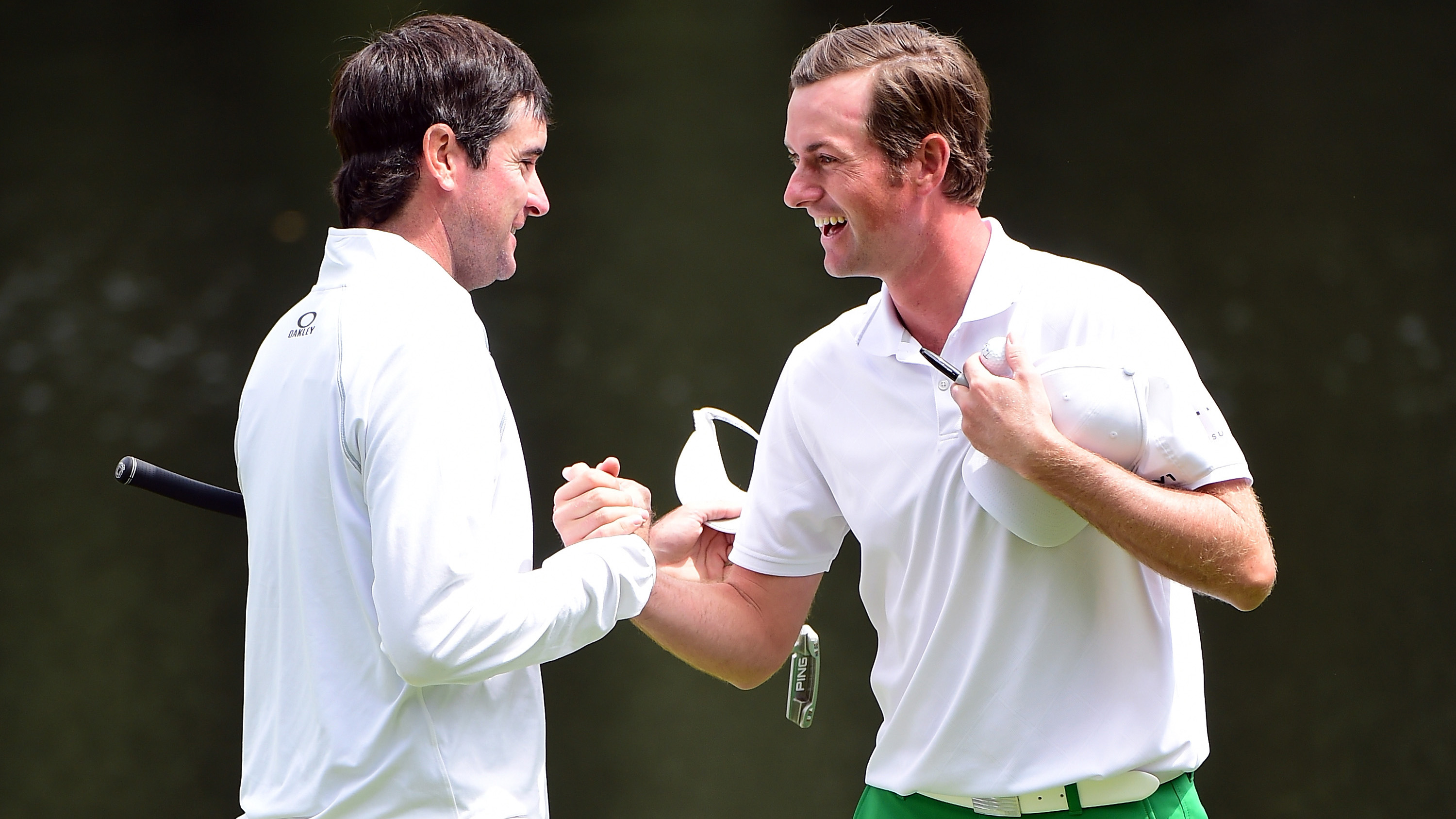 AUGUSTA, GEORGIA - APRIL 06:  Bubba Watson of the United States and Webb Simpson of the United States embrace on the ninth green during the Par 3 Contest prior to the start of the 2016 Masters Tournament at Augusta National Golf Club on April 6, 2016 in Augusta, Georgia.  (Photo by Harry How/Getty Images)