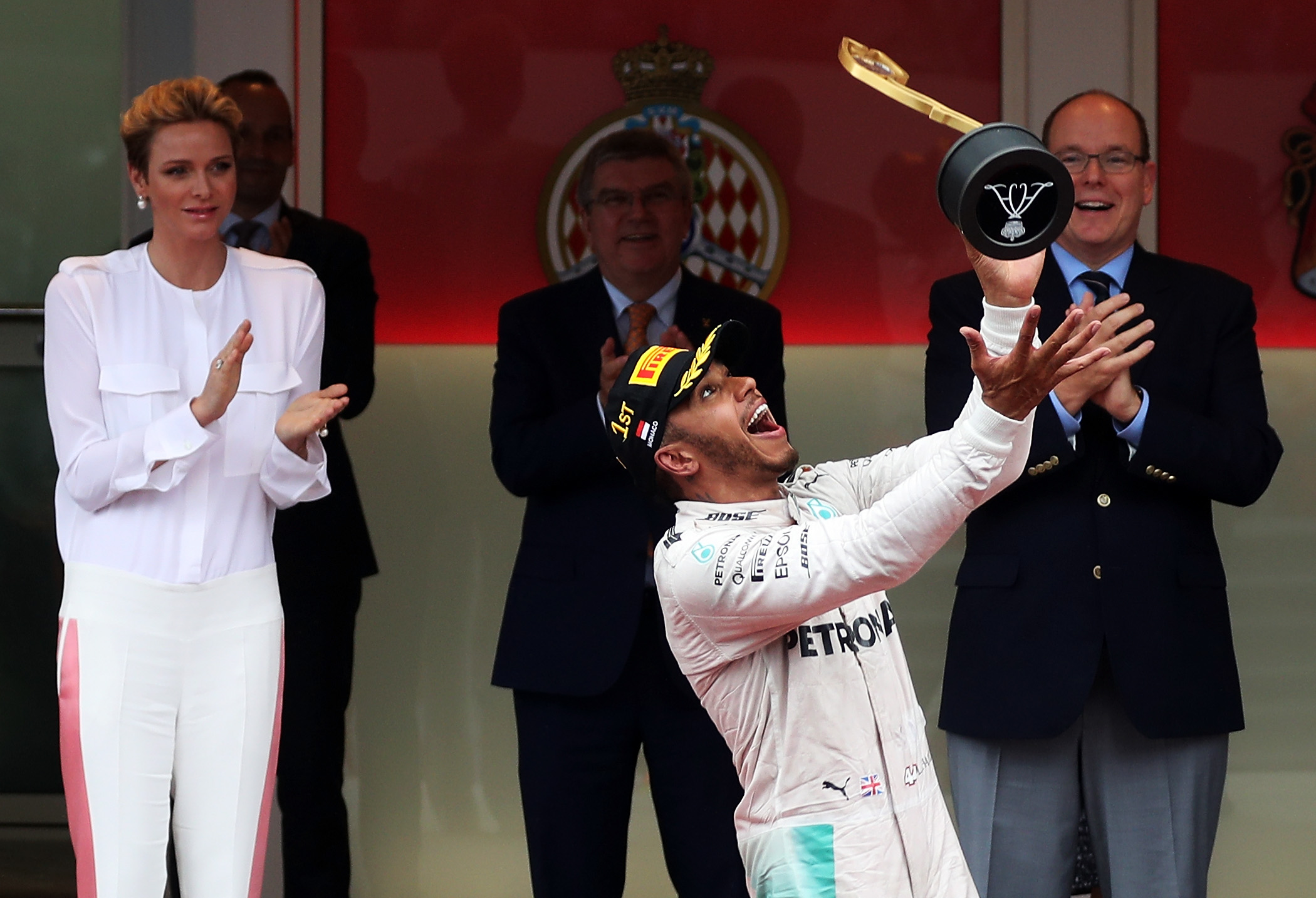 MONTE-CARLO, MONACO - MAY 29: Lewis Hamilton of Great Britain and Mercedes GP celebrates his win on the podium during the Monaco Formula One Grand Prix at Circuit de Monaco on May 29, 2016 in Monte-Carlo, Monaco. (Photo by Lars Baron/Getty Images)