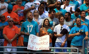 MIAMI GARDENS, FL - SEPTEMBER 25: Fan's stand for a moment of silences for Miami Marlins Pitcher Jose Fernandez prior to a game between the Miami Dolphins and the Cleveland Browns on September 25, 2016 in Miami Gardens, Florida. Fernandez was killed in a boating accident early this morning.  (Photo by Marc Serota/Getty Images)
