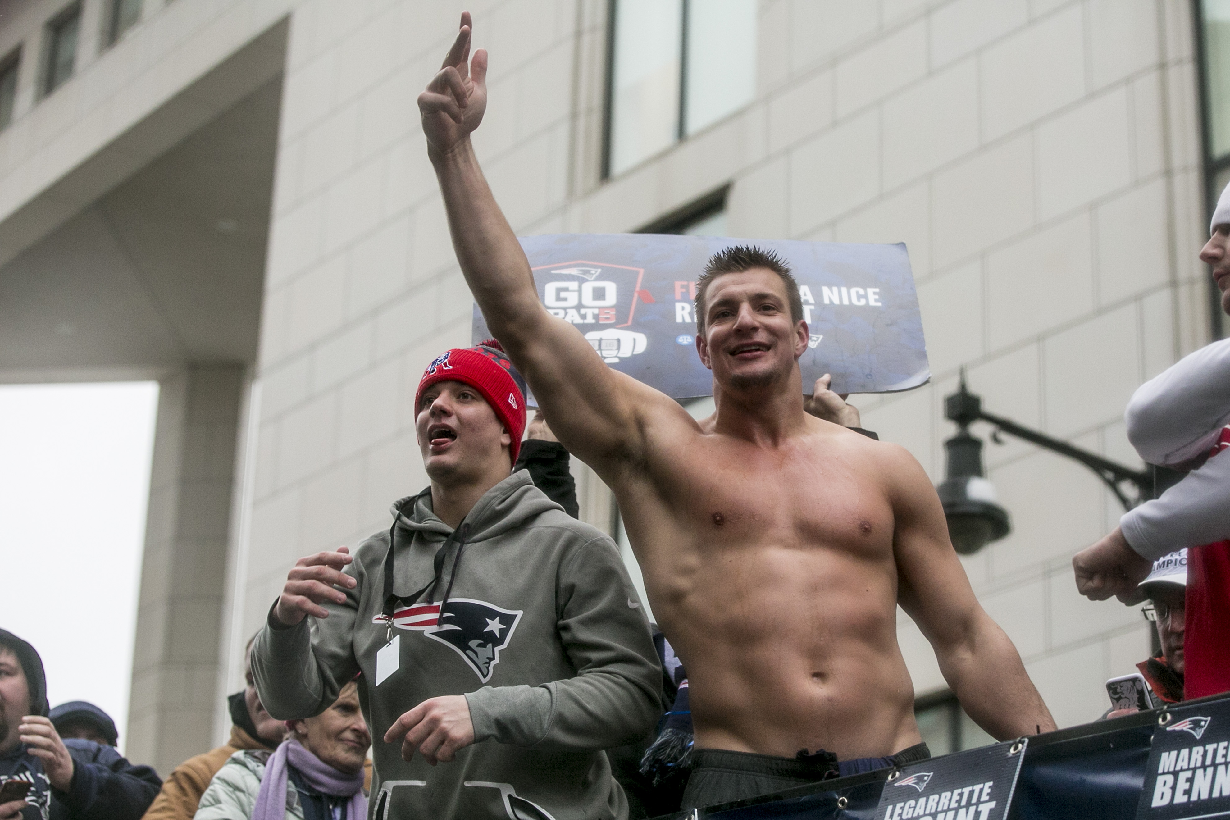 BOSTON, MA - FEBRUARY 07: Rob Gronkowski of the New England Patriots (R) celebrates during the Super Bowl victory parade on February 7, 2017 in Boston, Massachusetts. The Patriots defeated the Atlanta Falcons 34-28 in overtime in Super Bowl 51. (Photo by Billie Weiss/Getty Images)