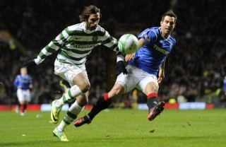 Rangers' Carlos Bocanegra challenges Celtic's Georgios Samaras during their Scottish Premier League 'Old Firm' derby soccer match