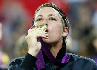 Abby Wambach of the U.S. kisses her gold medal after winning the women's soccer final against Japan during the victory ceremony at Wembley Stadium during the London 2012 Olympic Games