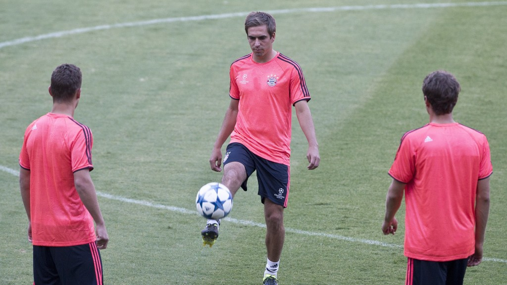 Bayern's Philipp Lahm controls the ball during a training session at the Georgios Karaiskakis stadium in Piraeus port, near Athens, Tuesday, Sept. 15, 2015. Bayern Munich will play against Olympiakos on Wednesday in a Champions League Group F soccer match. (AP Photo/Petros Giannakouris)