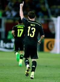Spain's Juan Mata raises his hand after scoring the opening goal against Macedonia during the Euro 2016 qualifying match between Macedonia and Spain at the Philip II stadium, in Skopje, Tuesday, Sept. 8, 2015. (AP Photo/Vlatko Perkovski)