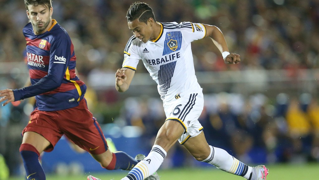 PASADENA, CA - JULY 21: Ariel Lassiter #46 of the Los Angeles Galaxy takes a shot past Gerard Pique #3 of FC Barcelona in the International Champions Cup 2015 at Rose Bowl on July 21, 2015 in Pasadena, California. FC Barcelona won 2-1. (Photo by Stephen Dunn/Getty Images)
