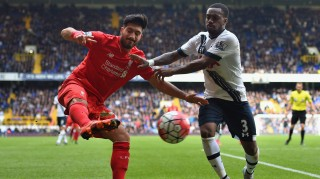 LONDON, ENGLAND - OCTOBER 17: Emre Can of Liverpool and Danny Rose of Tottenham Hotspur compete for the ball during the Barclays Premier League match between Tottenham Hotspur and Liverpool at White Hart Lane on October 17, 2015 in London, England. (Photo by Michael Regan/Getty Images)