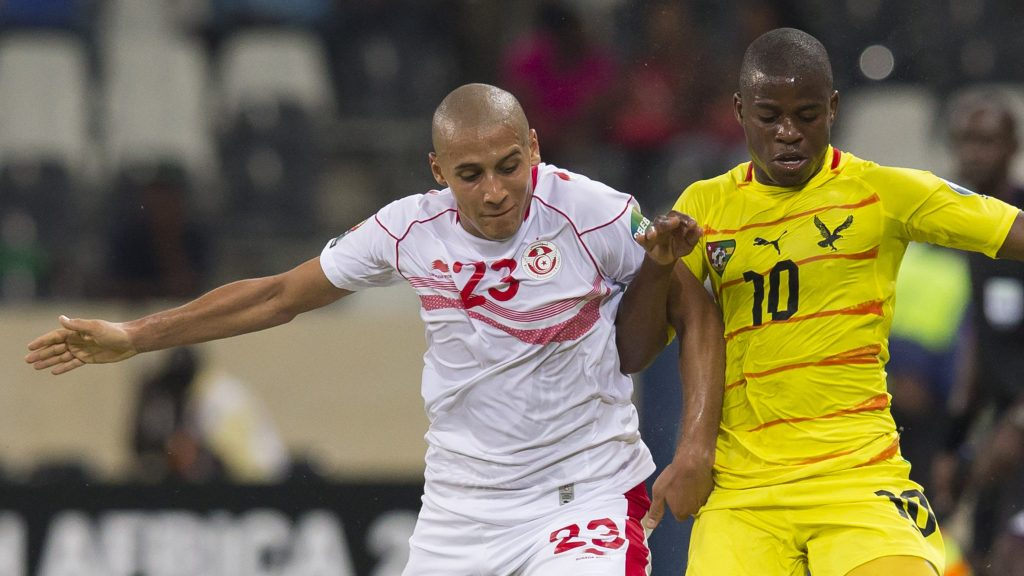NELSPRUIT, SOUTH AFRICA - JANUARY 30: Wahbi Khazri of Tunisia (L) and Floyd Ama Ayite of Togo during the 2013 Orange African Cup of Nations match between Togo and Tunisia at Mbombela Stadium on January 30, 2013 in Nelspruit, South Africa.(Photo by Manus van Dyk/Gallo Images/Getty Images)