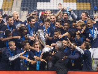 PHILADELPHIA, PA - SEPTEMBER 30: Sporting Kansas City celebrates with the Lamar Hunt trophy after defeating the Philadelphia Union in penalty kicks on September 30, 2015 at PPL Park in Chester, Pennsylvania. (Photo by Mitchell Leff/Getty Images)