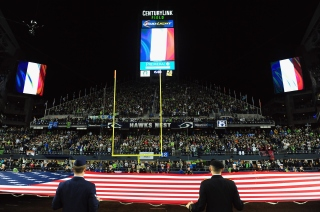SEATTLE, WA - NOVEMBER 15: French flags are displayed alongside the American flag in honor of the victims of the recent terrorist attacks in Paris prior to the game between the Seattle Seahawks and the Arizona Cardinals at CenturyLink Field on November 15, 2015 in Seattle, Washington. (Photo by Steve Dykes/Getty Images)