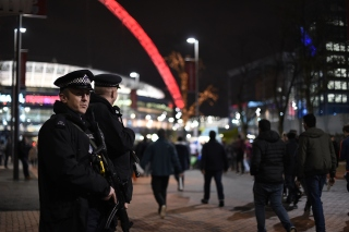 LONDON, ENGLAND - NOVEMBER 17: Armed Police Officers stand outside Wembley Stadium ahead of tonight's International friendly match between England and France at Wembley Stadium on November 17, 2015 in London, England. (Photo by Ben Pruchnie/Getty Images)
