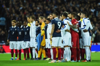 LONDON, ENGLAND - NOVEMBER 17: Both teams stand together for a moment of applause prior to the International Friendly match between England and France at Wembley Stadium on November 17, 2015 in London, England. (Photo by Shaun Botterill/Getty Images)
