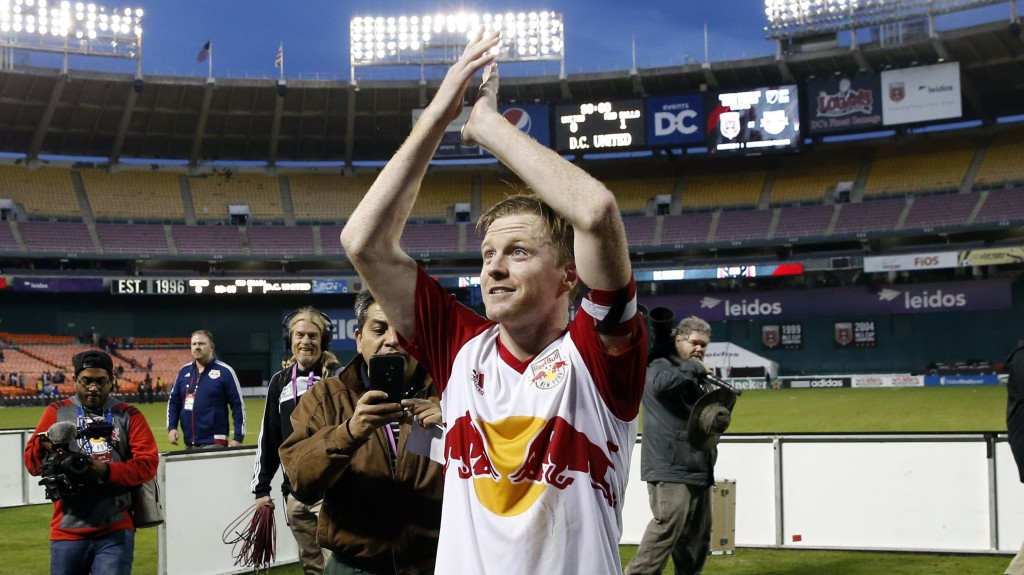 New York Red Bulls midfielder Dax McCarty reacts towards the fans after an MLS playoff soccer match against the D.C. United, at RFK Stadium, Sunday, Nov. 1, 2015, in Washington. McCarty scored the only goal and New York won 1-0. (AP Photo/Alex Brandon)