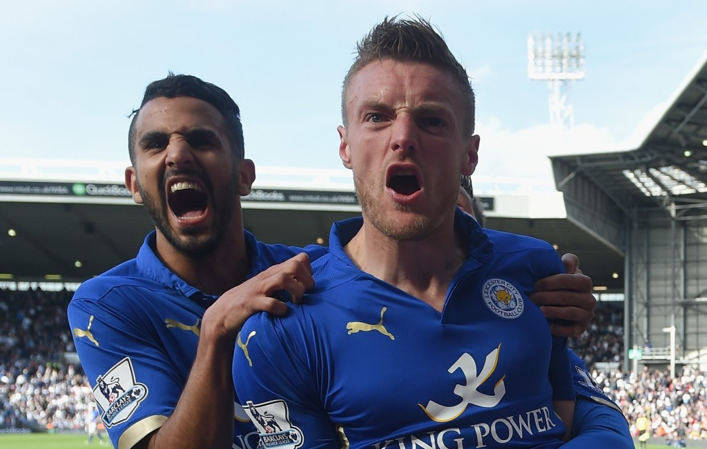 WEST BROMWICH, ENGLAND - APRIL 11: Jamie Vardy of Leicester City (R) with Riyad Mahrez of Leicester City (L) celebrates scoring the third goal with team mates during the Barclays Premier League match between West Bromwich Albion and Leicester City at The Hawthorns on April 11, 2015 in West Bromwich, England. (Photo by Michael Regan/Getty Images)