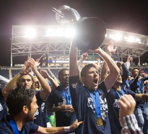 PHILADELPHIA, PA - SEPTEMBER 30: Krizstian Nemeth #9 of Sporting Kansas City holds up the Lamar Hunt trophy after defeating the Philadelphia Union in the U.S. Open Cup Final on September 30, 2015 at PPL Park in Chester, Pennsylvania. Sporting Kansas City defeated the Philadelphia Union in penalty kicks. (Photo by Mitchell Leff/Getty Images)