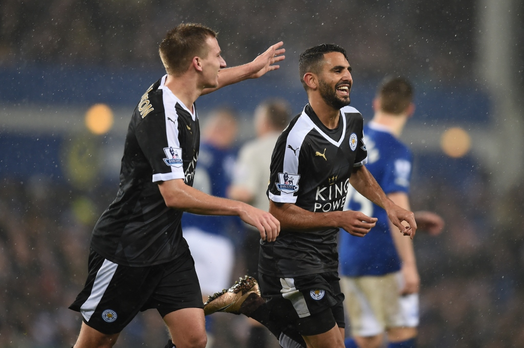 LIVERPOOL, ENGLAND - DECEMBER 19: Riyad Mahrez (R) of Leicester City celebrates scoring his team's second goal with his team mate Marc Albrighton (L) during the Barclays Premier League match between Everton and Leicester City at Goodison Park on December 19, 2015 in Liverpool, England. (Photo by Michael Regan/Getty Images)