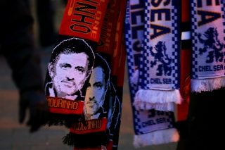 MANCHESTER, ENGLAND - DECEMBER 28:  Manchester United scarves displaying the image of former Chelsea manager Jose Mourinho are sold outside the stadium before the Barclays Premier League match between Manchester United and Chelsea at Old Trafford on December 28, 2015 in Manchester, England.  (Photo by Alex Livesey/Getty Images)