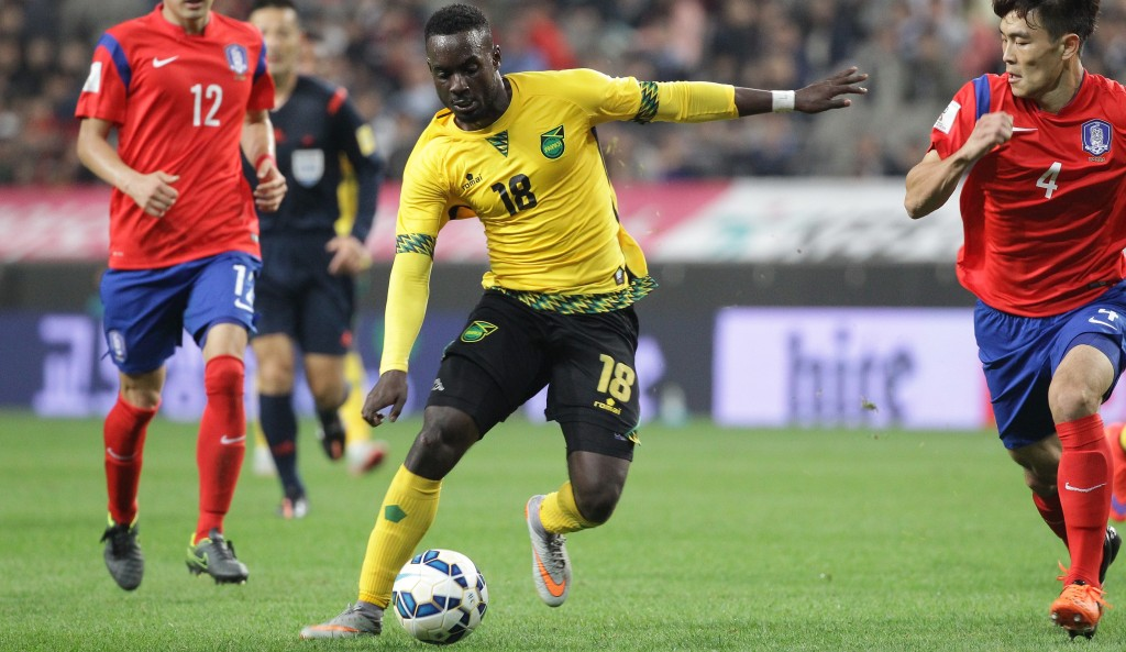 SEOUL, SOUTH KOREA - OCTOBER 13:  Simon Dawkins of Jamaica competes for the ball with Kim Kee-Hee of South Korea during the international friendly match between South Korea and Jamaica at Seoul World Cup stadium on October 13, 2015 in Seoul, South Korea.  (Photo by Chung Sung-Jun/Getty Images)