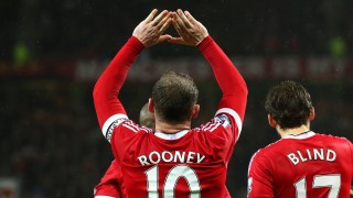 MANCHESTER, ENGLAND - JANUARY 02: Wayne Rooney of Manchester United celebrates scoring his team's second goal during the Barclays Premier League match between Manchester United and Swansea City at Old Trafford on January 2, 2016 in Manchester, England. (Photo by Alex Livesey/Getty Images)