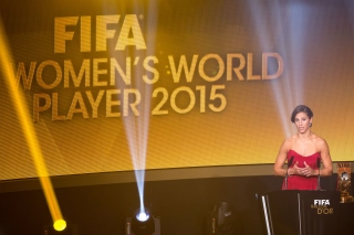 ZURICH, SWITZERLAND - JANUARY 11: FIFA Women's World Player of the Year winner Carli Lloyd of the USA and Houston Dash arrives on stage to deliver a speech during the FIFA Ballon d'Or Gala 2015 at the Kongresshaus on January 11, 2016 in Zurich, Switzerland. (Photo by Philipp Schmidli/Getty Images)