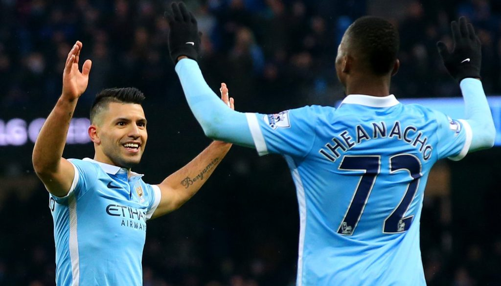 MANCHESTER, ENGLAND - JANUARY 16: Sergio Aguero of Manchester City celebrates with team-mate Kelechi Iheanacho after scoring his team's second goal during the Barclays Premier League match between Manchester City and Crystal Palace at Etihad Stadium on January 16, 2016 in Manchester, England. (Photo by Alex Livesey/Getty Images)