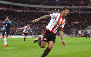 SUNDERLAND, ENGLAND - JANUARY 23: Patrick van Aanholt of Sunderland celebrates scoring his team's first goal during the Barclays Premier League match between Sunderland and A.F.C. Bournemouth at the Stadium of Light on January 23, 2016 in Sunderland, England. (Photo by Gareth Copley/Getty Images)