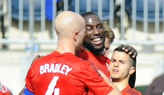 Toronto FC forward Sebastian Giovinco (10) celebrates after scoring on a penalty kick with teammates Jozy Altidore (17), Michael Bradley (4) and Jackson Goncalves (11) during the first half of an MLS soccer match against the Philadelphia Union, Saturday, May 2, 2015, in Chester, Pa. Toronto FC won 1-0. (AP Photo/Michael Perez)