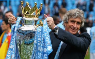 MANCHESTER, ENGLAND - MAY 11: The Manchester City Manager Manuel Pellegrini poses with the Premier League trophy at the end of the Barclays Premier League match between Manchester City and West Ham United at the Etihad Stadium on May 11, 2014 in Manchester, England. (Photo by Alex Livesey/Getty Images)