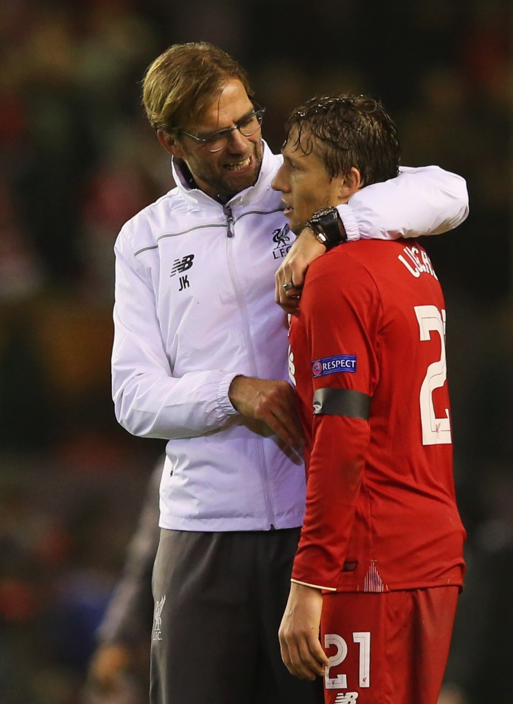LIVERPOOL, ENGLAND - NOVEMBER 26: Jurgen Klopp manager of Liverpool embraces Lucasof Liverpool after victory in the UEFA Europa League Group B match between Liverpool FC and FC Girondins de Bordeaux at Anfield on November 26, 2015 in Liverpool, United Kingdom. (Photo by Alex Livesey/Getty Images)