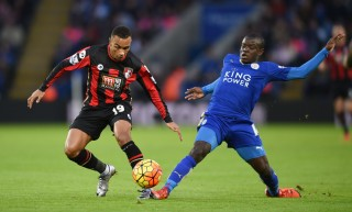 LEICESTER, ENGLAND - JANUARY 02: Junior Stanislas of Bournemouth and Ngolo Kante of Leicester City compete for the bacompete for the ballduring the Barclays Premier League match between Leicester City and Bournemouth at The King Power Stadium on January 2, 2016 in Leicester, England. (Photo by Michael Regan/Getty Images)
