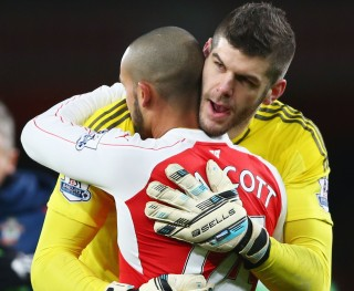 LONDON, ENGLAND - FEBRUARY 02: Fraser Forster of Southampton greets with Theo Walcott of Arsenal after the Barclays Premier League match between Arsenal and Southampton at the Emirates Stadium on February 2, 2016 in London, England. (Photo by Paul Gilham/Getty Images)