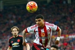SUNDERLAND, ENGLAND - FEBRUARY 13: DeAndre Yedlin of Sunderland is tackled by Cameron Borthwick-Jackson of Manchester United during the Barclays Premier League match between Sunderland and Manchester United at the Stadium of Light on February 13, 2016 in Sunderland, England. (Photo by Clive Brunskill/Getty Images)