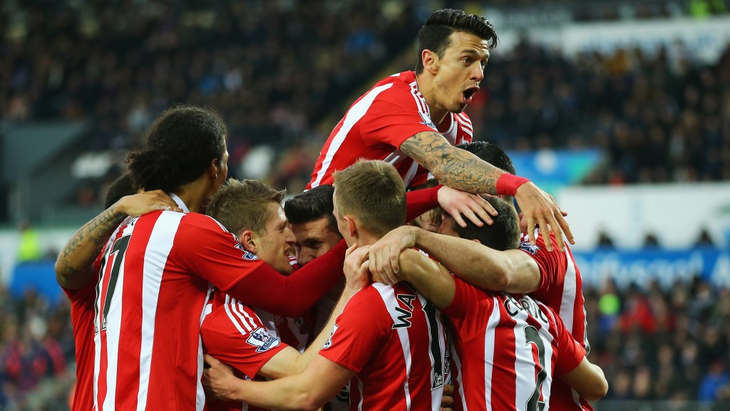 SWANSEA, WALES - FEBRUARY 13: Southampton players celebrate their team's first goal by Shane Long (obscured) during the Barclays Premier League match between Swansea City and Southampton at Liberty Stadium on February 13, 2016 in Swansea, Wales. (Photo by Richard Heathcote/Getty Images)