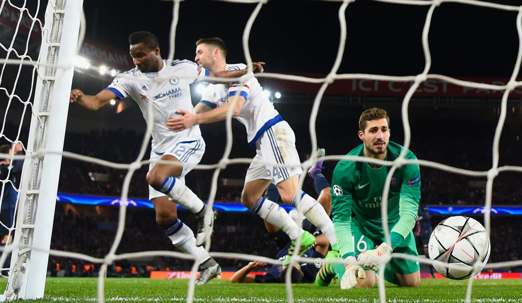 PARIS, FRANCE - FEBRUARY 16:  John Mikel Obi of Chelsea (L) celebrates with Gary Cahill as he scores their first and equalising goal past goalkeeper Kevin Trapp of Paris Saint-Germain during the UEFA Champions League round of 16 first leg match between Paris Saint-Germain and Chelsea at Parc des Princes on February 16, 2016 in Paris, France.  (Photo by Mike Hewitt/Getty Images)