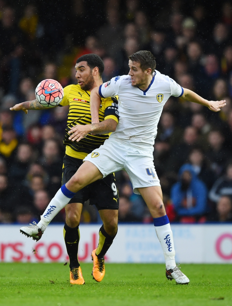 WATFORD, ENGLAND - FEBRUARY 20: Scott Wootton of Leeds United and Troy Deeney of Watford compete for the ball during the Emirates FA Cup fifth round match  between Watford and Leeds United at Vicarage Road on February 20, 2016 in Watford, England.  (Photo by Shaun Botterill/Getty Images)
