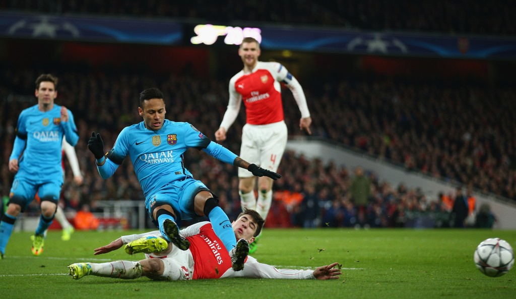 LONDON, ENGLAND - FEBRUARY 23: Hector Bellerin of Arsenal makes a tackle on Neymar of Barcelona during the UEFA Champions League round of 16 first leg match between Arsenal and Barcelona on February 23, 2016 in London, United Kingdom. (Photo by Paul Gilham/Getty Images)