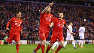 LIVERPOOL, ENGLAND - FEBRUARY 25: James Milner (C) of Liverpool celebrates scoring his team's first goal with his team mates Roberto Firmino (L) and Philippe Coutinho (R) during the UEFA Europa League Round of 32 second leg match between Liverpool and FC Augsburg at Anfield on February 25, 2016 in Liverpool, United Kingdom. (Photo by Clive Brunskill/Getty Images)