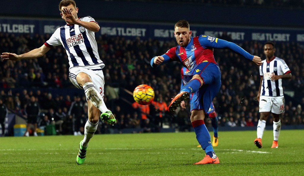 WEST BROMWICH, ENGLAND - FEBRUARY 27:  Connor Wickham of Crystal Palace shoots past Gareth McAuley of West Bromwich Albion to score their second goal during the Barclays Premier League match between West Bromwich Albion and Crystal Palace at The Hawthorns on February 27, 2016 in West Bromwich, England.  (Photo by Nigel Roddis/Getty Images)