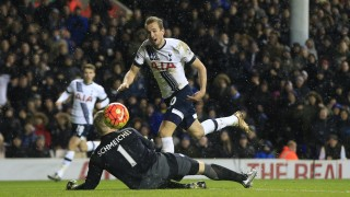 Tottenham Hotspur's Harry Kane, right, lifts the ball over Leicester City's goalkeeper Kasper Schmeichel but fails to score during their English Premier League soccer match between Tottenham Hotspur and Leicester City at the White Hart Lane stadium in London Wednesday, Jan. 13, 2016. (AP Photo/Alastair Grant)