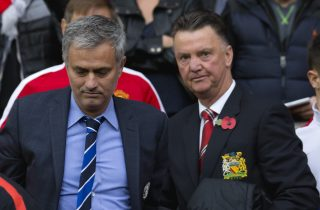Chelsea's manager Jose Mourinho, center left, makes his way from the opposition dugout after greeting Manchester United manager Louis van Gaal, centre right, during their English Premier League soccer match between Manchester United and Chelsea at Old Trafford Stadium, Manchester, England, Sunday Oct. 26, 2014. (AP Photo/Jon Super)