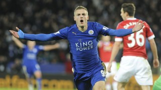 Leicester's Jamie Vardy celebrates after scoring against Manchester United, his eleventh consecutive goal in the Premier League, during the English Premier League soccer match between Leicester City and Manchester United at the King Power Stadium, Leicester, England, Saturday, Nov. 28, 2015. Vardy becomes the first man to score in 11 consecutive English Premier League soccer matches after finding the back of the net against Manchester United today.(AP Photo/Rui Vieira)