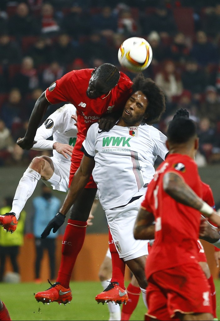 Augsburg's Caiuby, right, and Liverpool's Mamadou Sakho challenge for the ball during the Europa League soccer match between FC Augsburg and FC Liverpool in Augsburg, southern Germany, Thursday, Feb. 18, 2016. (AP Photo/Matthias Schrader)